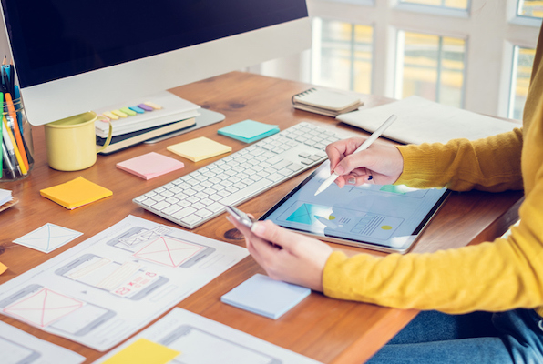 woman choosing elements to include in her company's website
