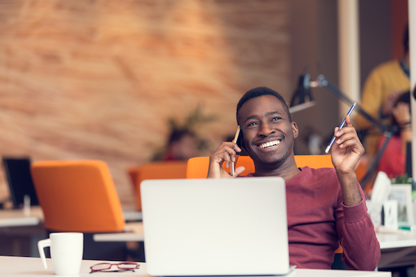 ultimate guide to company culture man smiling while on the phone