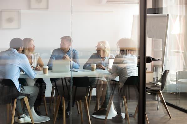 Enterprise sales team discusses project management tactics