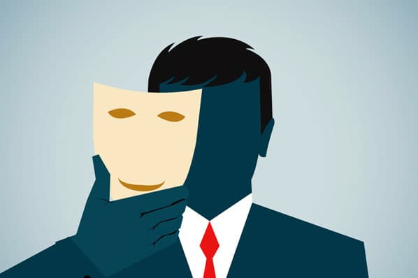 A person dealing with imposter syndrome removes a mask they've been hiding behind.