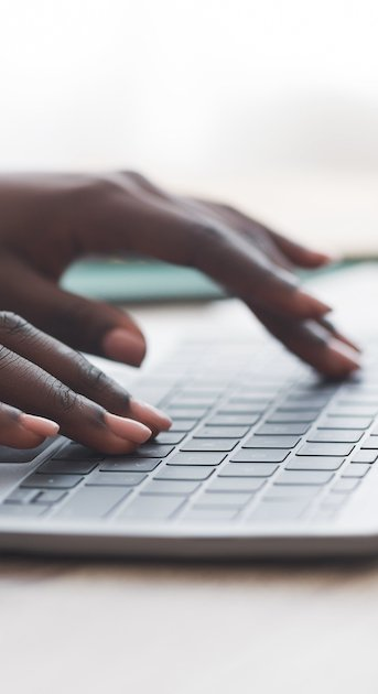 hands typing on a keyboard to create an AB test