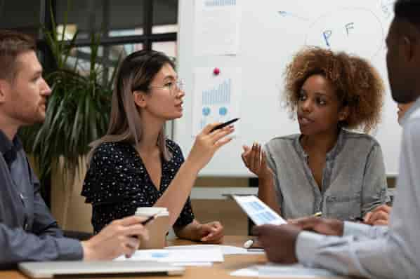 businesspeople working together as a team and using interpersonal skills for collaboration