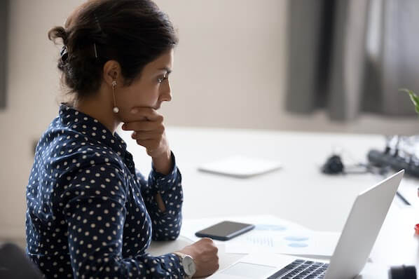 woman using a laptop computer to resolve the