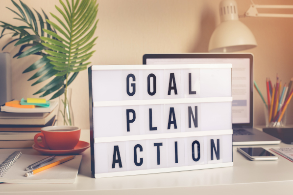 marketing objectives sign that says 'goal, plan, action'