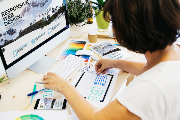 woman researching page layout design ideas