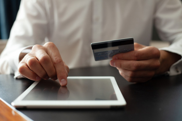 ecommerce customer entering information into payment gateway to process payment online
