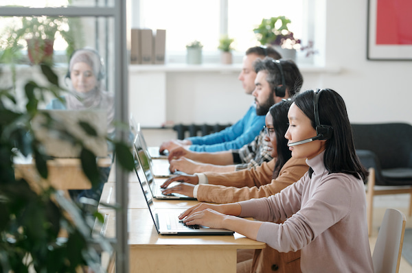 call center agents answering customer questions during a crisis
