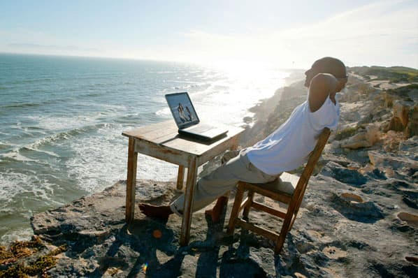 a person highlights a remote work myth that people work on the beach.