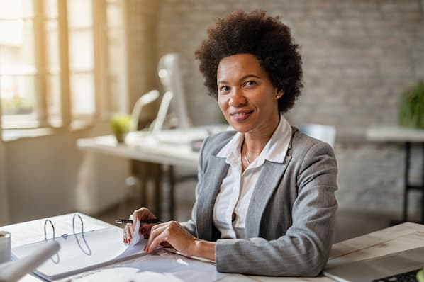 woman in sales looks through customer information