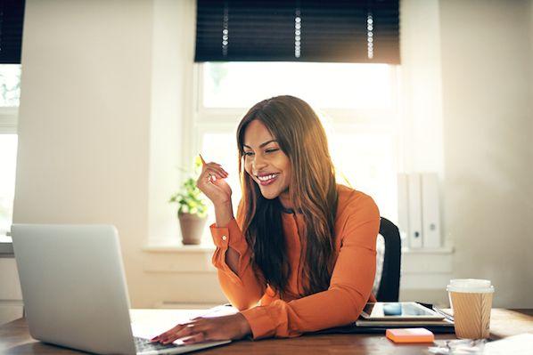 woman-laughing-at-computer