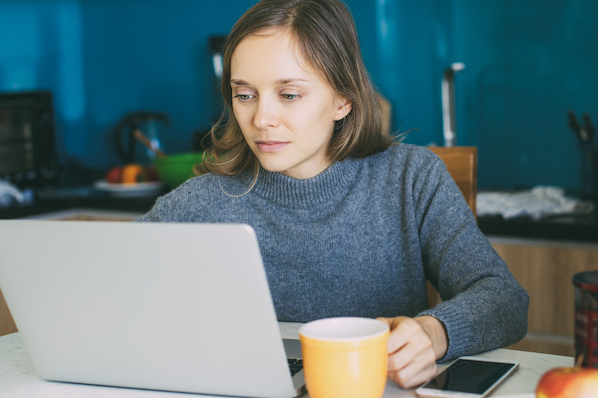 person using a laptop to download a wordpress CRM plugin